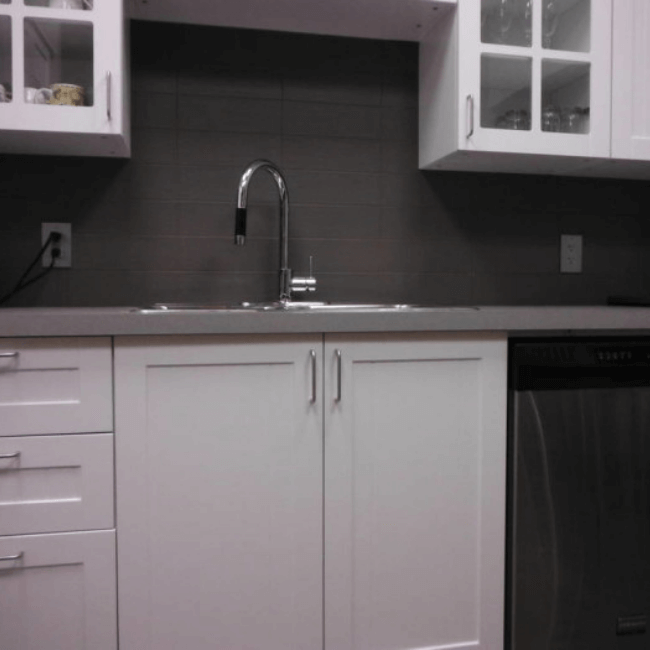 kitchen sink and white cupboards